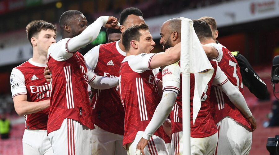 Lacazette celebrating as he converts from the spot.
