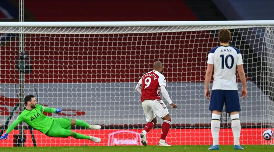 Lacazette sends Hugo Lloris the wrong way from the penalty spot.